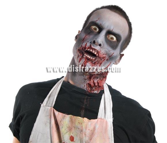 Kit maquillaje Zombies para Halloween. Éste Halloween con un poco de maña y paciencia te podrás hacer un maquillaje como el de la imagen. Incluye dentadura, esponja, sangre y crema de maquillaje blanca, 2 pastillas de cera moldeadora de color marrón y set de maquillaje con pincel aplicador, 2 tonos de maquillaje (verde y morado) y 2 barras de maquillaje pequeñas (1 negra y una blanca). Lo necesario para hacerte un buen maquillaje de Zombie.