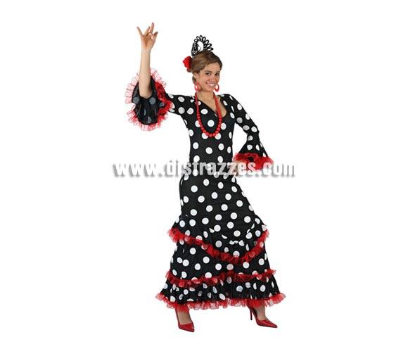 Disfraz de Faralae negro con lunares blancos para mujer. Talla 2 ó talla standar M-L = 38/42. Incluye vestido y tocado. Éste es un bonito traje de Andaluza o Sevillana de mujer.