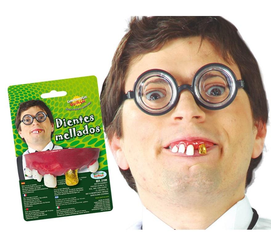 Dentadura o Dientes mellado de tonto con un diente dorado.