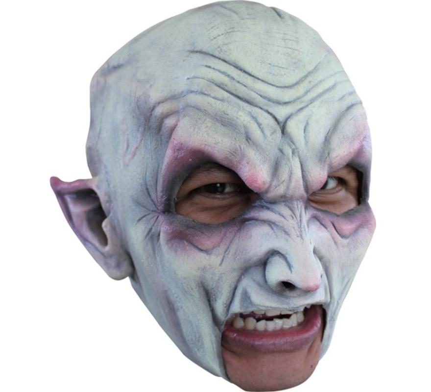 Máscara Chinless Vampire de látex para Halloween. Alta calidad. Fabricada en látex artesanalmente por una empresa que hace efectos especiales para Hollywood. Máscara de Vampiro sin mentón para dar terror en Halloween. Original y novedosa máscara con la que se puede beber y fumar sin ningún problema.