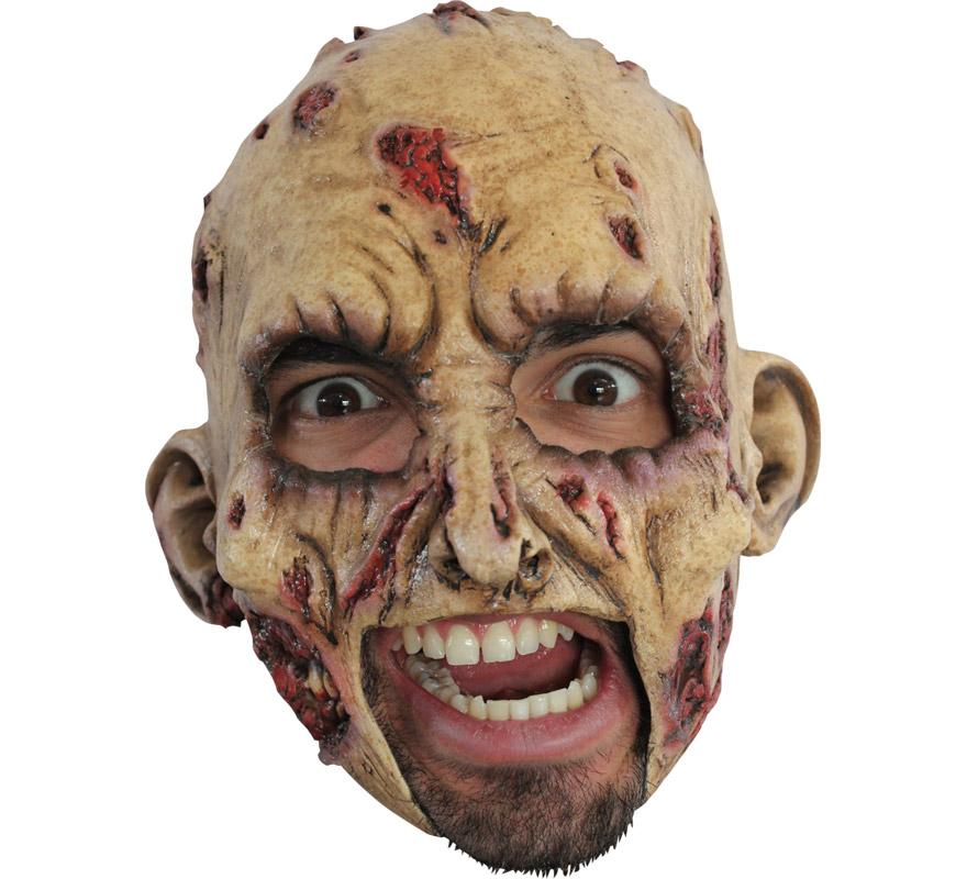 Máscara Chinless Zombie de látex para Halloween. Alta calidad. Fabricada en látex artesanalmente por una empresa que hace efectos especiales para Hollywood. Máscara de Zombie sin mentón para dar terror en Halloween. Original y novedosa máscara con la que se puede beber y fumar sin ningún problema.