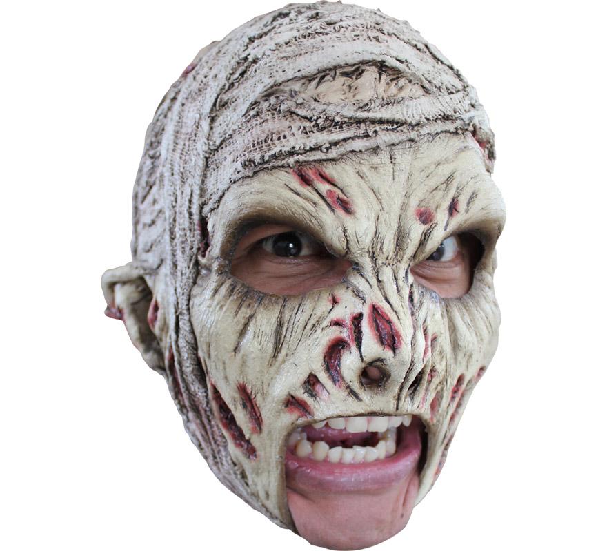 Máscara Chinless Mummy de látex para Halloween. Alta calidad. Fabricada en látex artesanalmente por una empresa que hace efectos especiales para Hollywood. Máscara de La Momia sin mentón para dar terror en Halloween. Original y novedosa máscara con la que se puede beber y fumar sin ningún problema.
