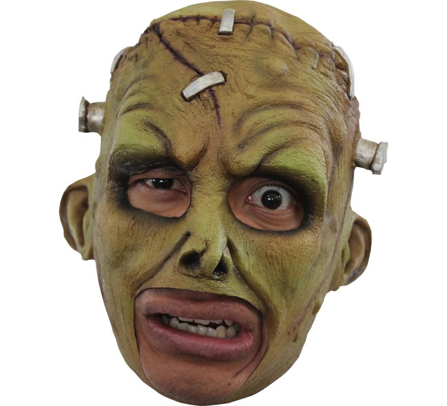 Máscara Chinless Franky de látex para Halloween. Alta calidad. Fabricada en látex artesanalmente por una empresa que hace efectos especiales para Hollywood. Máscara de Frankenstein sin mentón para dar terror en Halloween. Original y novedosa máscara con la que se puede beber y fumar sin ningún problema.