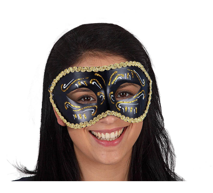 Máscara o antifaz Veneciano negra con detalles dorados.
