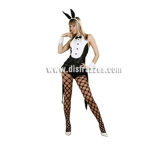 Disfraz de Conejita Sexy con esmoquin para mujer. Talla standar M-L 38/42. Incluye esmoquin, puños, tocado, orejas de conejita. Medias NO incluidas, podrás verlas en la sección de Complementos. ¿Te atreves?