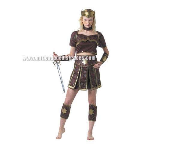 Disfraz de Guerrera adulta. Talla única 42/44. Incluye camisa, falda, muñequeras y espinilleras. Disfraz de Gladiadora.
