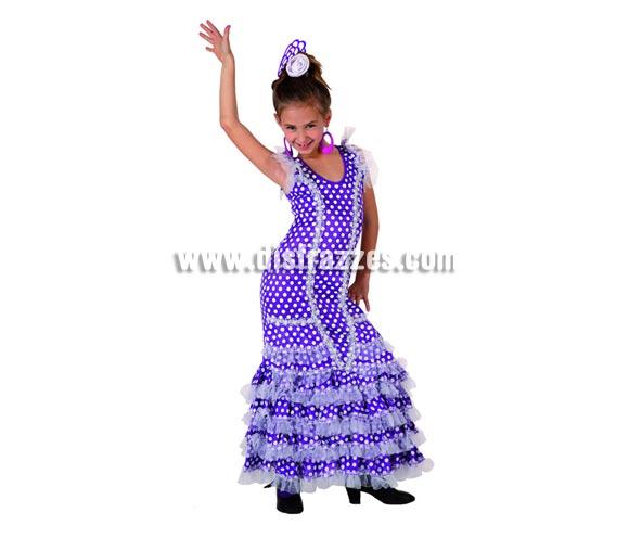Disfraz de Sevillana Púrpura con lunar blanco para niñas de 5 a 6 años. Incluye vestido y flor de la cabeza. Pendientes y Peineta NO incluidas, podrás verlas en la sección de Complementos.